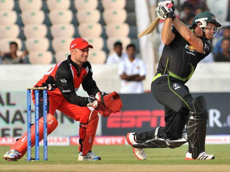 Warriors batsman Colin Ingram plays a shot as Timothy Paul Ludeman watches during the Champions League Twenty20 Group B cricket match in Hyderabad.