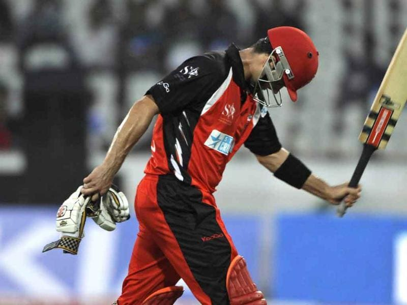 South Australia batsman Callum Ferguson reacts as he walks back after being dismissed during the Champions League Twenty20 cricket match in Hyderabad.
