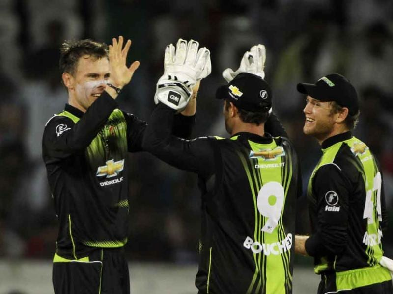 Warriors bowler Johan Botha (L) celebrates the wicket of South Australia's batsman during the Champions League Twenty20 cricket match in Hyderabad.