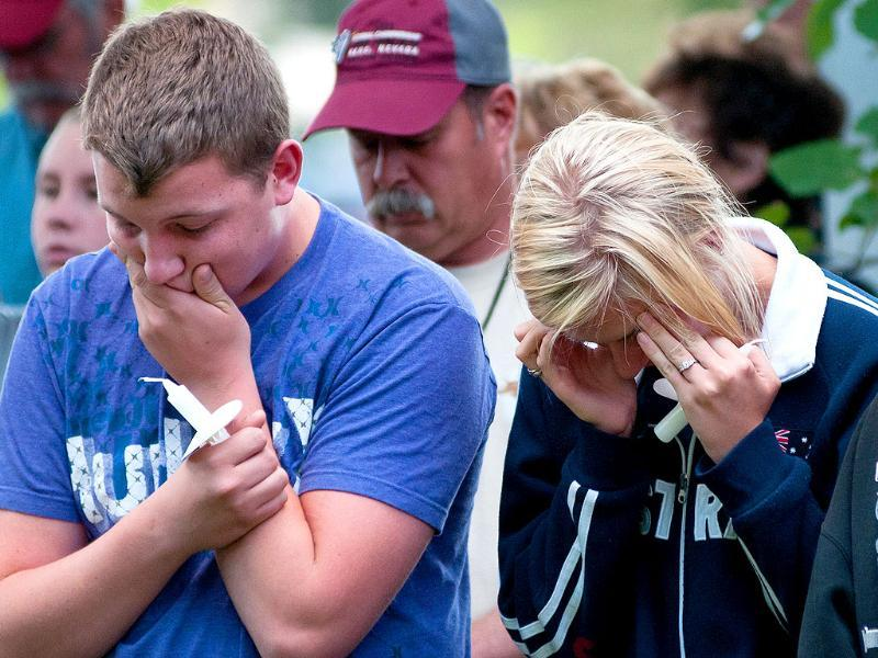 Two young people react while attending the Reno memorial service for the victims of the September 16 crash at the National Championship Air Races.