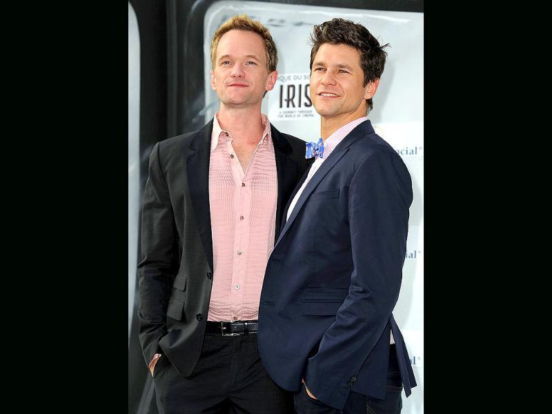 Actor Neil Patrick Harris (L) and David Burtka (R) attend the IRIS, A Journey Through the World of Cinema by Cirque du Soleil premiere in Hollywood, California.