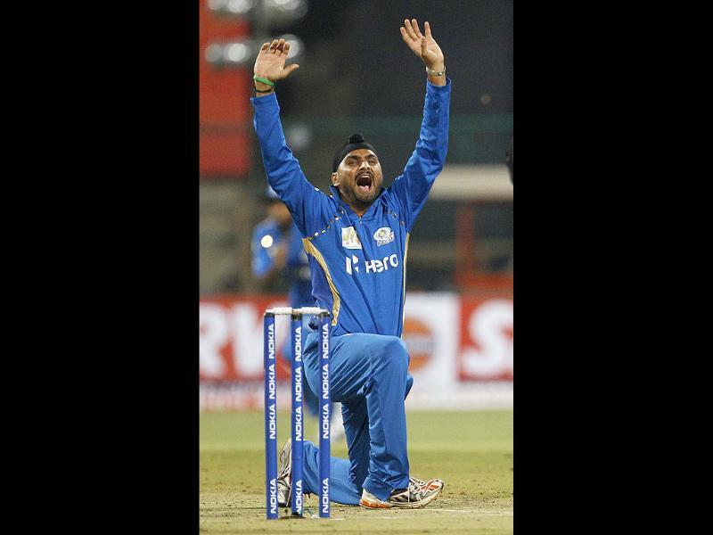 Mumbai Indians captain Harbhajan Singh appeals for the wicket of Trinidad and Tobago batsman Darren Bravo during their Champions League Twenty20 cricket match in Bangalore.