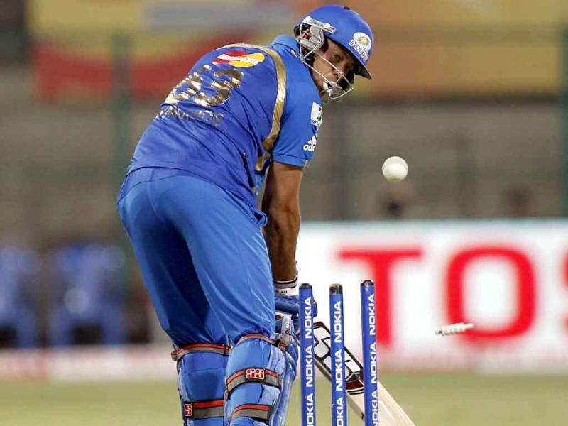 Andrew Symonds of Mumbai Indians gets bowled out during the CLT20 match between Trinidad and Tobago and Mumbai Indians.