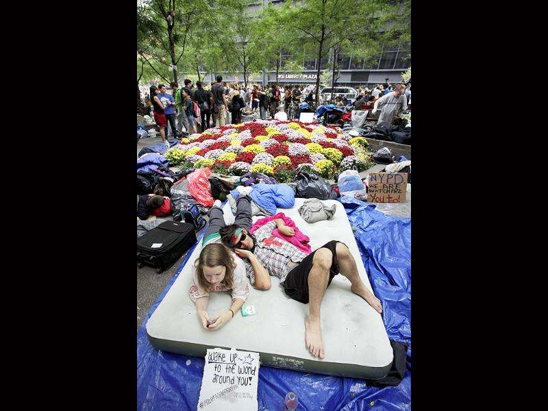 Amber Oestreich and Robert Grodt, who are part of the protest movement, rest on a mattress in Zuccotti Park.