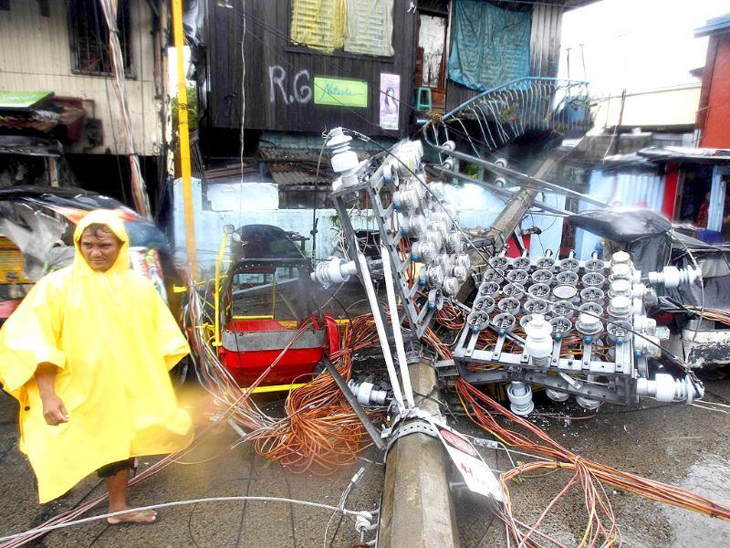 An electric post is seen after it slammed into a house after heavy winds brought by Typhoon Nesat, locally known as Pedring, hit Tondo city, metro Manila.