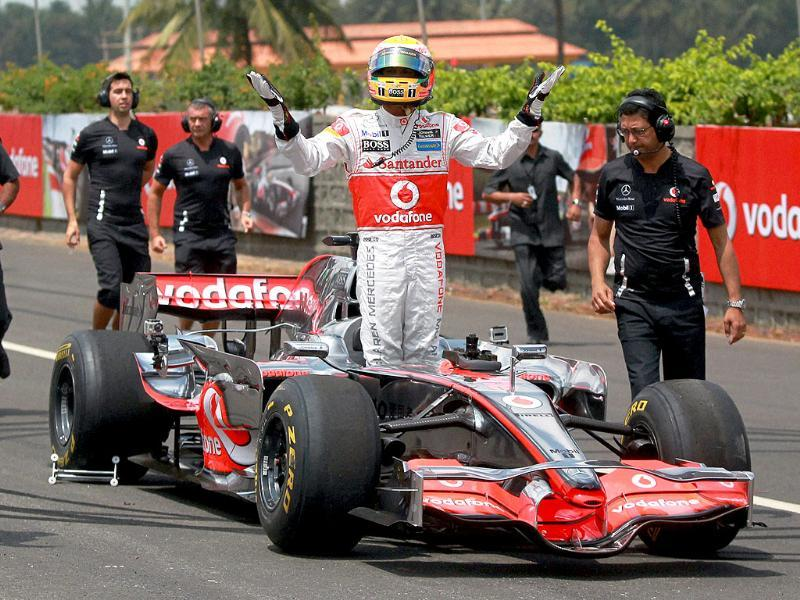 Rockstar F1 driver Lewis Hamilton waves to his fans as he stands on his award winning MP4-23 car after finisheing the Formula One car run at nice road in Bangalore. The India Grand Prix is scheduled to be held for the first time in the country in New Delhi.