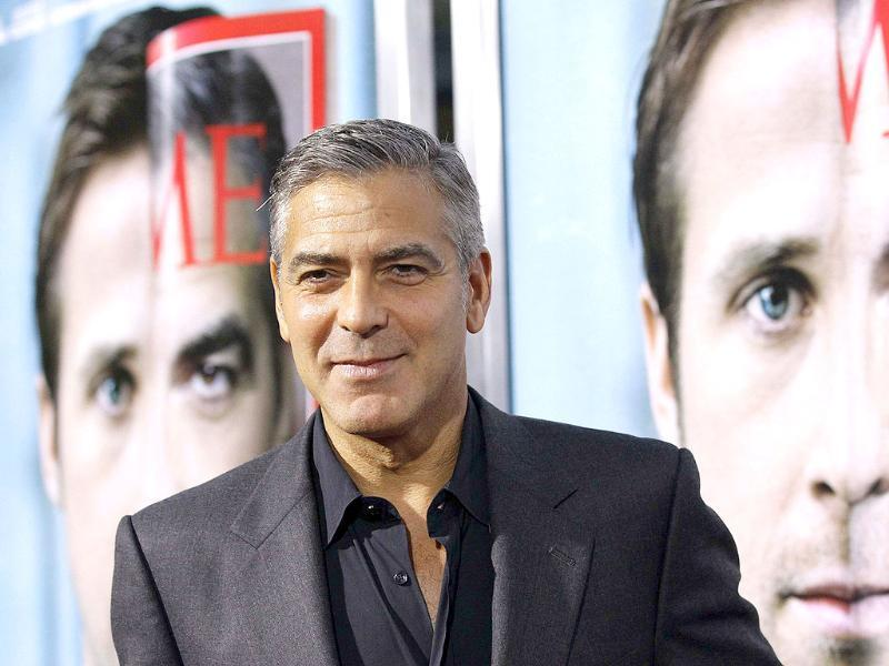 Director and cast member George Clooney poses at the premiere of The Ides Of March at the Samuel Goldwyn theatre in Beverly Hills, California.