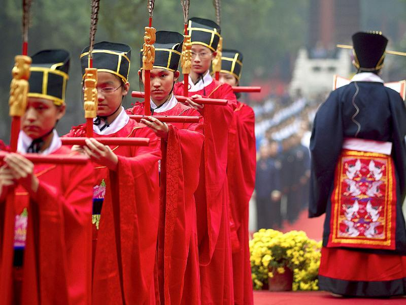 School children dressed as ancient Chinese scholars take part in a traditional ritual to celebrate Confucius' birthday, known as National Teacher's Day in China at the Confucius Temple in Beijing, China.
