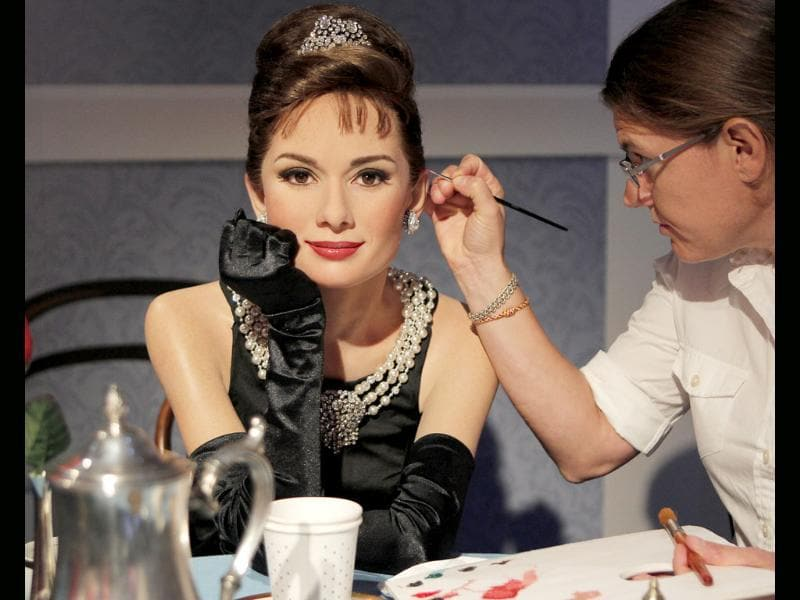 Figure production maintenance manager Petra van der Meer retouches Audrey Hepburn's wax figure at the Madame Tussauds wax exhibition in Tokyo, Japan.