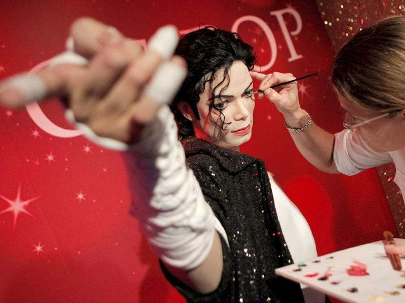 Figure production maintenance manager Petra van der Meer retouches Michael Jackson's wax figure at the Madame Tussauds exhibition in Tokyo, Japan.