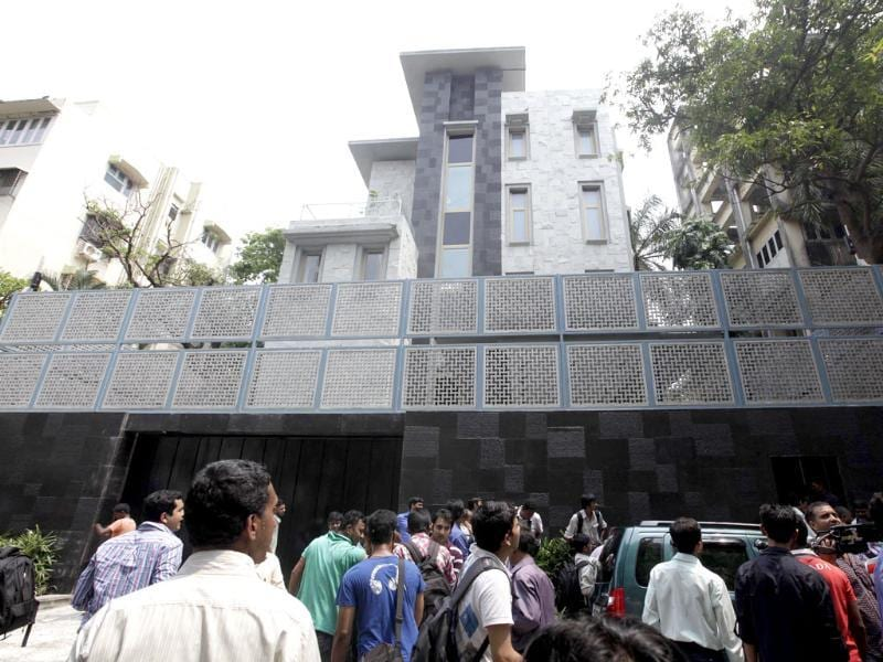 People gather outside Sachin Tendulkar's new house in Bandra area in Mumbai.