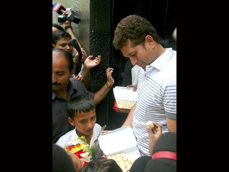 Sachin Tendulkar talks to the media after shifting to the new house at Perry Cross Road in Bandra, Mumbai.