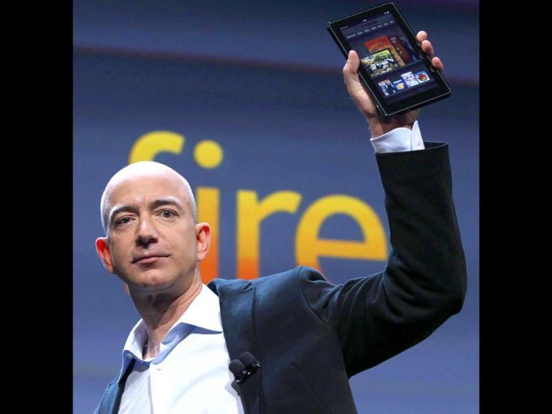 Jeff Bezos, Chairman and CEO of Amazon.com, introduces the Kindle Fire at a news conference in New York. The e-reader and tablet has a 7-inch (17.78 cm) multicolor touchscreen.
