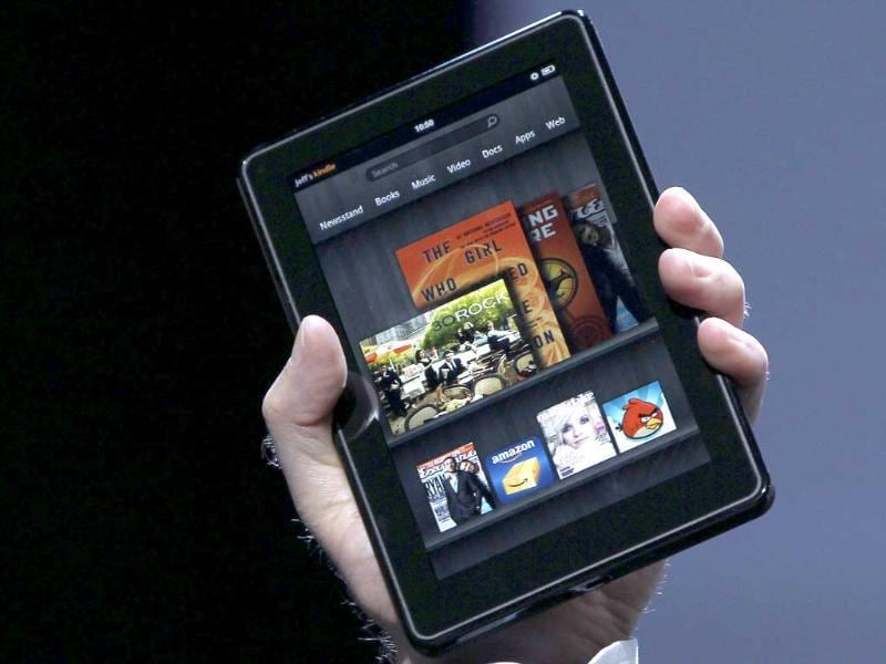 Amazon CEO Jeff Bezos holds up the new Kindle Fire at a news conference during the launch of Amazon's new tablets in New York.