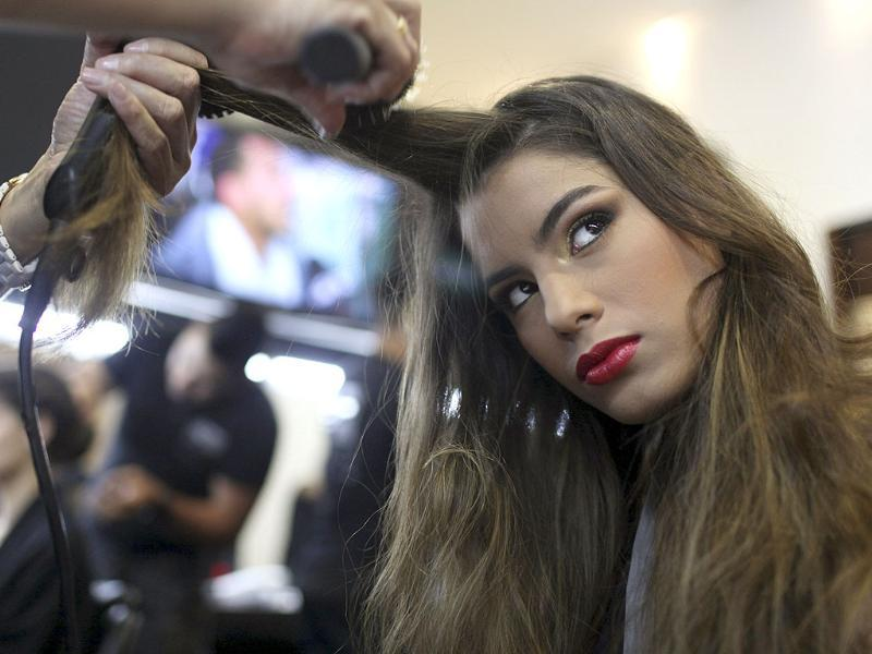 A model is prepared backstage before a show during the IXEL fashion event in Cartagena.