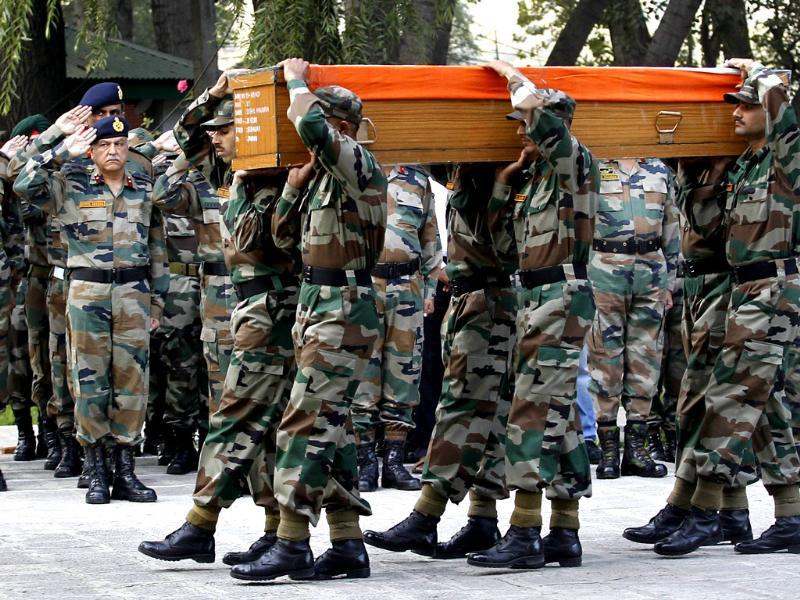 Army officers salute as soldiers carry a coffin containing the body of their colleague Lieutenant Sushil Khajuria, during a wreath laying ceremony in a military garrison in Srinagar. Lieutenant Khajuria, along with another soldier and two policemen were killed in a fierce gun battle with militants belonging to Lashkar-e-Toiba, a Pakistan based militant group, in the forest area of Kupwara in north Kashmir, said the Army's spokesman in Srinagar. Five militants have also been killed in the ongoing operation, added the spokesman.