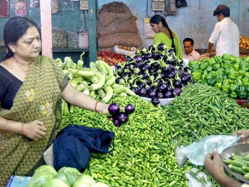 A customer buys vegetables at a market in Ahmedabad. The food price index rose 9.13% in the year to September 17, government data showed.