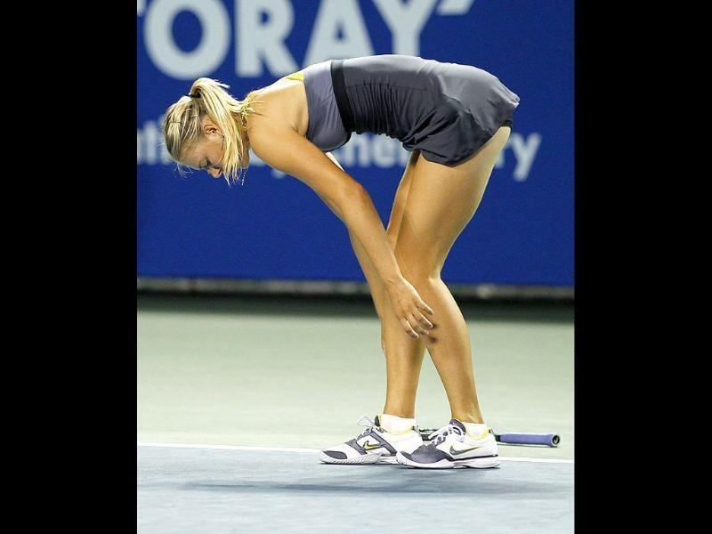 Maria Sharapova stands up after she injures her leg during her quarter-final match against Petra Kvitova of Czech Republic at the Pan Pacific Open tennis tournament in Tokyo.