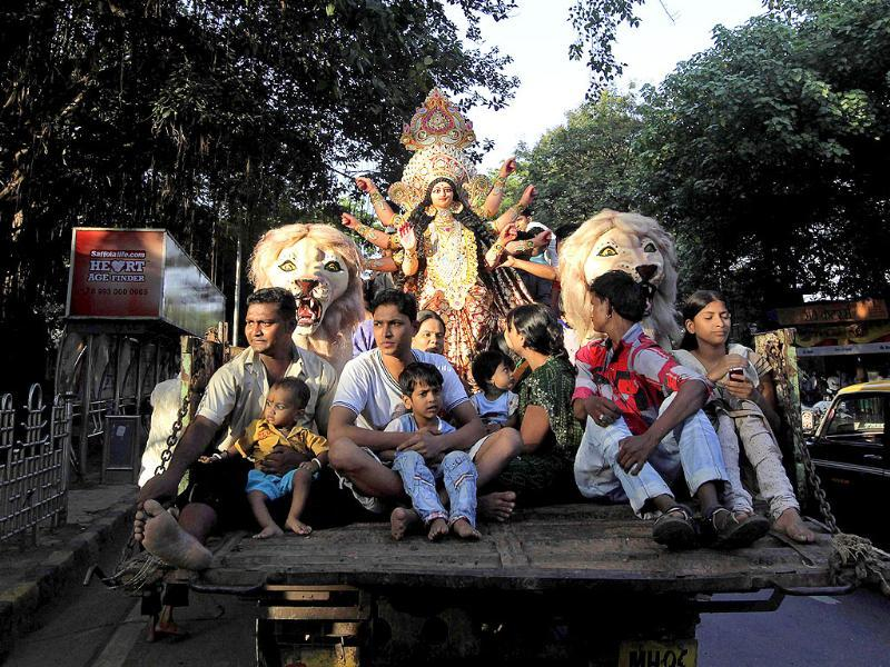 Devotees carry an idol of Goddess Durga for worship during Navratri festival in Mumbai.