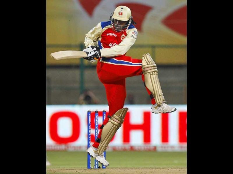 Royal Challengers Bangalore's batsman Chris Gayle plays a shot during the Champions League Twenty20 cricket match against Kolkata Knight Riders in Bangalore.