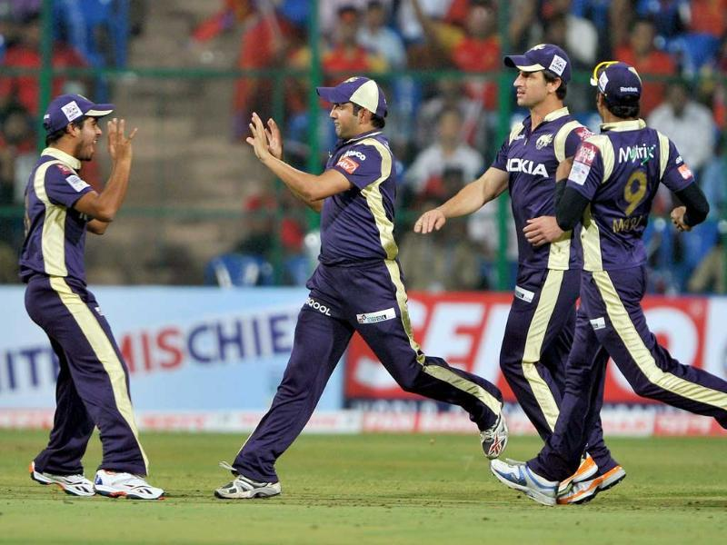 Gautam Gambhir celebrates the catch of Royal Challengers' batsman Virat Kholi (unseen) with his teammates during the Champions League Twenty20 League cricket match between Royal Challengers Bangalore versus Kolkata Knight Riders at the M. Chinnaswamy Stadium in Bangalore.