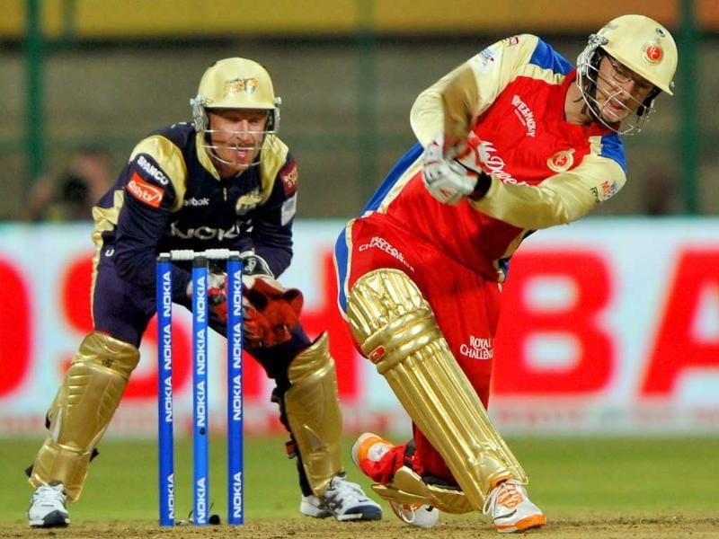 Daniel Vettori of Royal Challengers Bangalore knocks a six as wicketkeeper of Kolkata Knight Riders, Brad Haddin (L) looks during the Champions League Twenty20 League match between Royal Challengers Bangalore and Kolkata Knight Riders at the M. Chinnaswamy Stadium in Bangalore.
