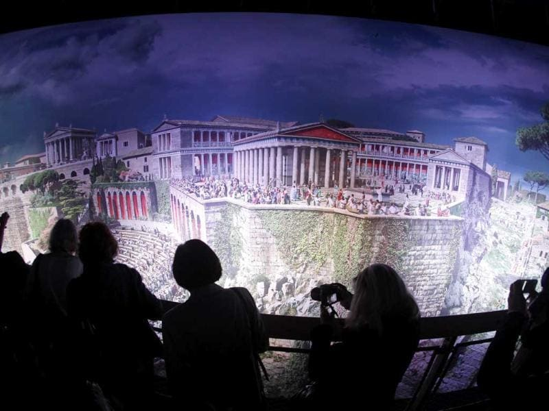 People watch the 'Pergamon - Panorama of the Ancient Metropolis' 360 degrees panorama created by artist Yadegar Asisi at an exhibition by the Collection of Classical Antiquities - National Museum during the press preview in Berlin. The condensed scenes depicted in Asisi panorama are 30 metres in height and 100 metres in length showing natural landscapes and the acropolis in Pergamon in the year 129 AD.
