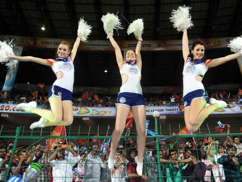 Cheerleaders perform during the match between Royal Challengers Bangalore and Kolkata Knight Riders for Chapions League T20-2011 in Bangalore.
