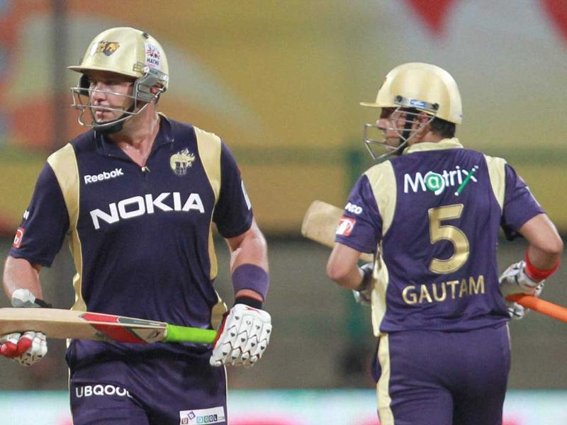 Kolkata Knight Riders' Jaquess Kallis and Skipper Gautam Gambhir run between the wickets against Royal Challengers Bangalore during the Champions league T20-2011 match in Bangalore.