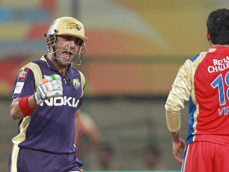 Kolkata Knight Riders' Skipper Gautam Gambhir celebrates the win against Royal Challengers Bangalore as Virat Kohli looks on during the Champions league T20-2011 match in Bangalore.