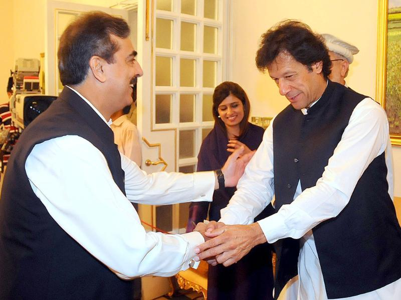 Pakistan's Prime Minister Yusuf Raza Gilani receives cricketer-turn-politician Imran Khan for an all parties conference in Islamabad, Pakistan.