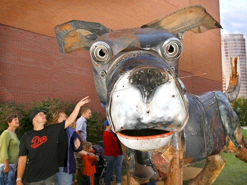 A giant dog created out of found objects, titled