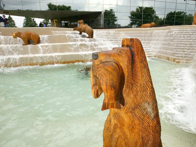 A bear carved from wood which is part of an ArtPrize entry by Llew Tilma titled