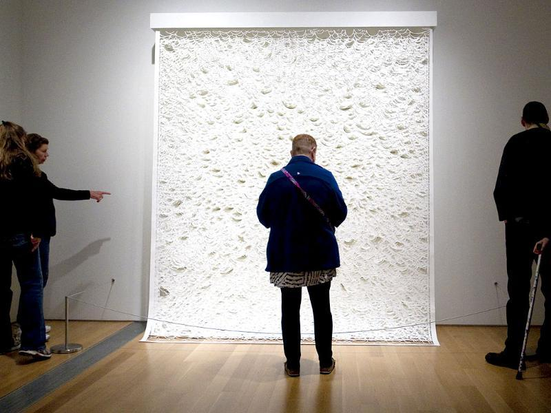 People look at Laura Alexander's ArtPrize entry,