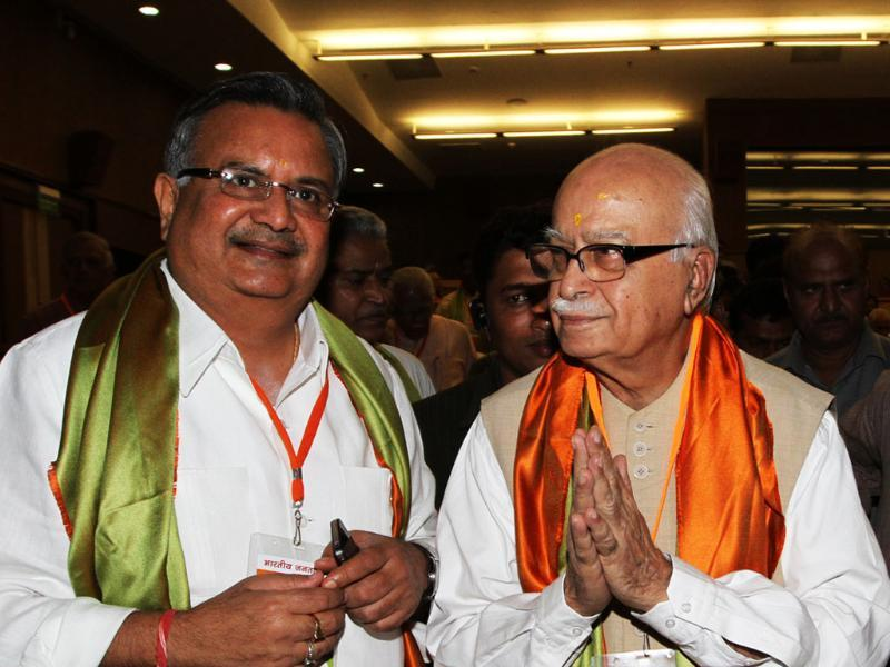 BJP leaders LK Advani with chief minister of Chhattisgarh, Raman Singh during national executive committee meeting of BJP in New Delhi.