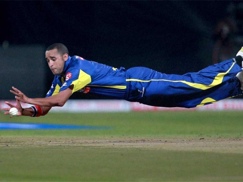 Cape Cobras' Robin Peterson fields the ball against Mumbai Indians during the Champions League T20-2011 match in Bangalore.