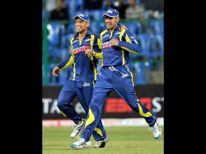 Justin Ontong and Owais Shah of Cape Cobras celebrate the dismissal of Ambati Rayudu (unseen) of Mumbai Indians during the Champions League Twenty20 match at the M Chinnaswamy Stadium in Bangalore.