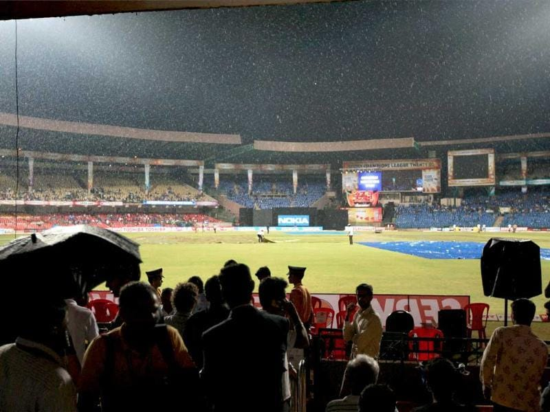 Groundsmen cover the ground as it rains during the match between Cape Cobras and Mumbai Indians at the Champions League T20-2011 in Bangalore.