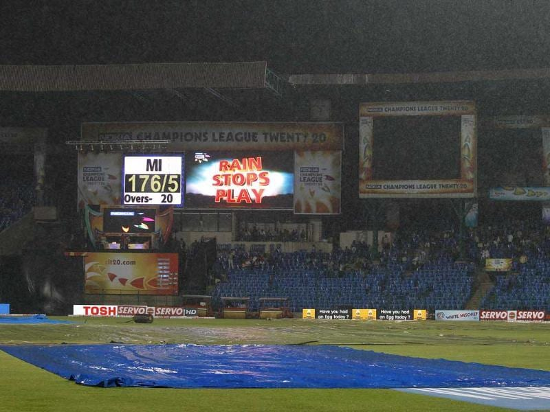 Plastic sheets cover the pitch area as rain stops play at the Champions League Twenty20 cricket match between Mumbai Indians and Cape Cobras in Bangalore.