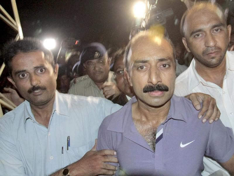 Suspended IPS officer Sanjeev Bhatt is escorted after his arrest by police in Ahmedabad.