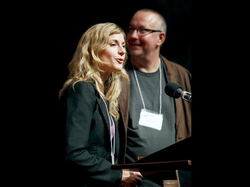 Mirjam Tuk, left, gives the acceptance speech after receiving the Ig Nobel prize in Medicine next to her colleague Luk Warlop during the 21st annual Ig Nobel Awards ceremony at Harvard University in Cambridge.