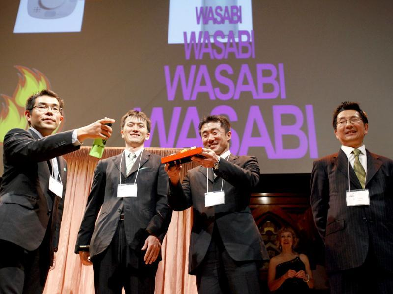 Ig Nobel prize winners in Chemistry, from left, Junichi Murakami, Koichiro Mizoguchi, Hideaki Goto, and Yukinobu Tajimadu stand on stage during the 21st annual Ig Nobel Awards ceremony at Harvard University in Cambridge.