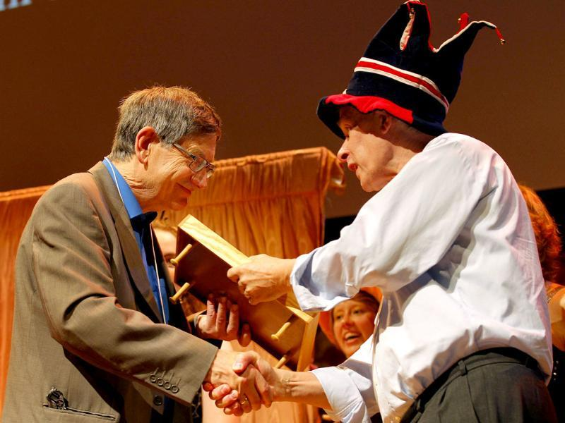 Karl Halvor Teigen (L) of the University of Oslo, receives a 2011 Ig Nobel prize, for trying to understand why, in everyday life, people sigh, during the 21st annual Ig Nobel prize ceremony at Harvard University in Cambridge. The annual prizes, meant to entertain and encourage scientific research, are awarded by the Journal of Improbable Research as a whimsical counterpart to the Nobel Prizes, which will be announced next week.