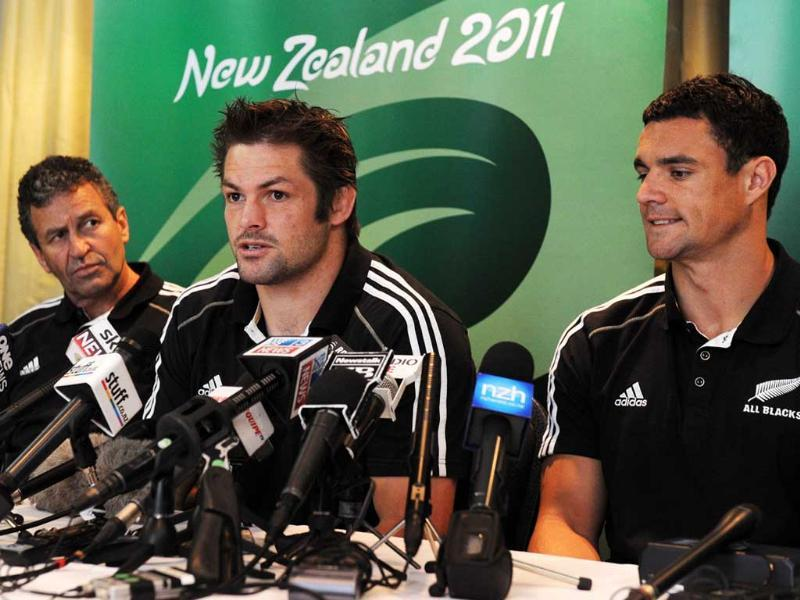 New Zealand All Black captain Richie McCaw announces he will not play in the next match due to injury as assistant coach Wayne Smith and acting captain Daniel Carter listen during a press conference in Wellington.