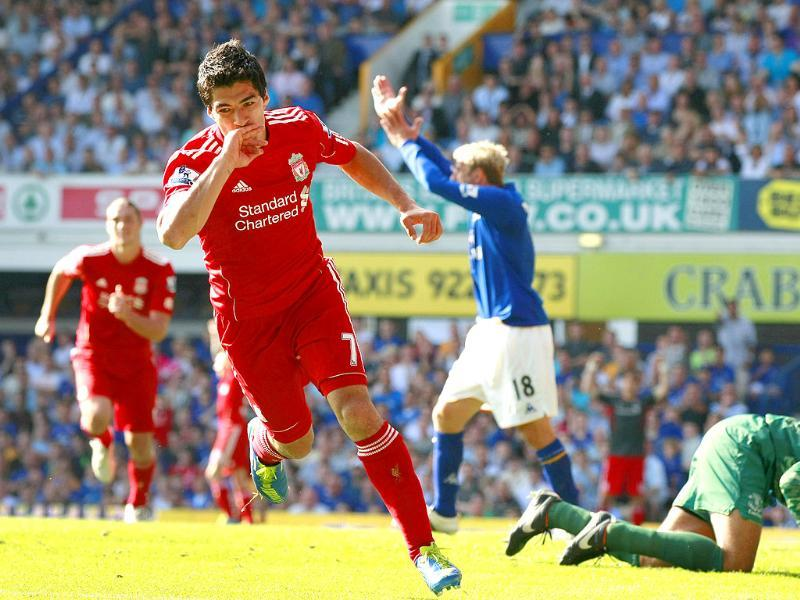 Liverpool's Luis Suarez (C) celebrates after scoring a goal against Everton during their English Premier League soccer match at Goodison Park, Liverpool in England.