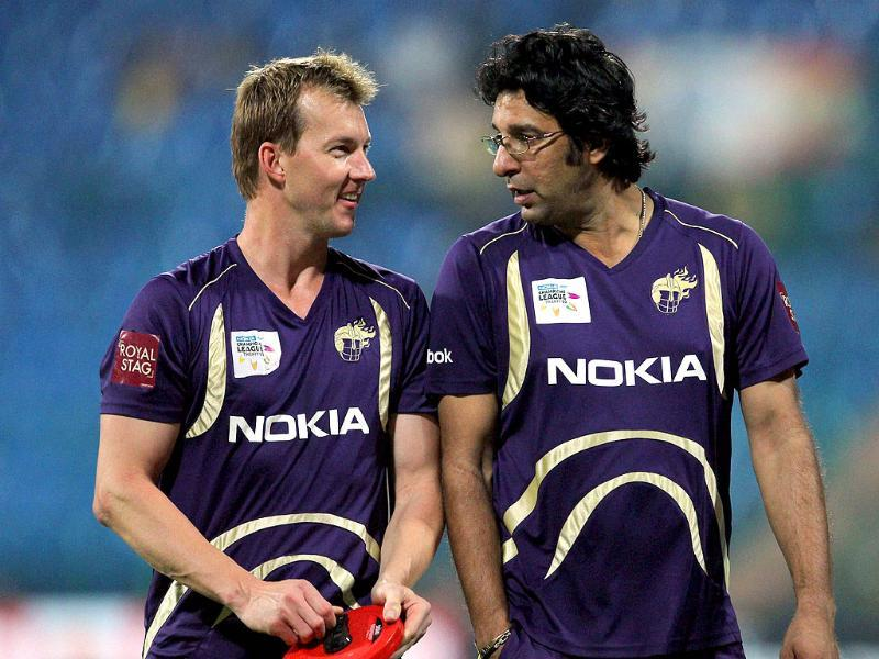 Kolkata Knight riders bowling coach Wasim Akram with bowler Brett Lee chat before the starting of the match against Warriors during the Champions League T20-2011 in Bangalore.