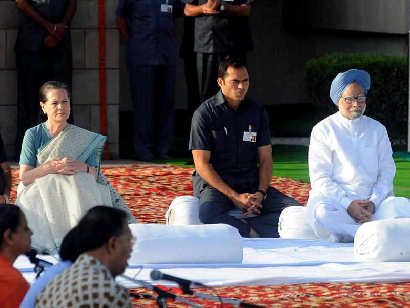 Chairperson of Congress-led UPA government Sonia Gandhi sits alongside Prime Minister Manmohan Singh after paying their respects at the memorial to the father of the nation Mahatma Gandhi at Rajghat in New Delhi in honour of Gandhi's 143rd birth anniversary.