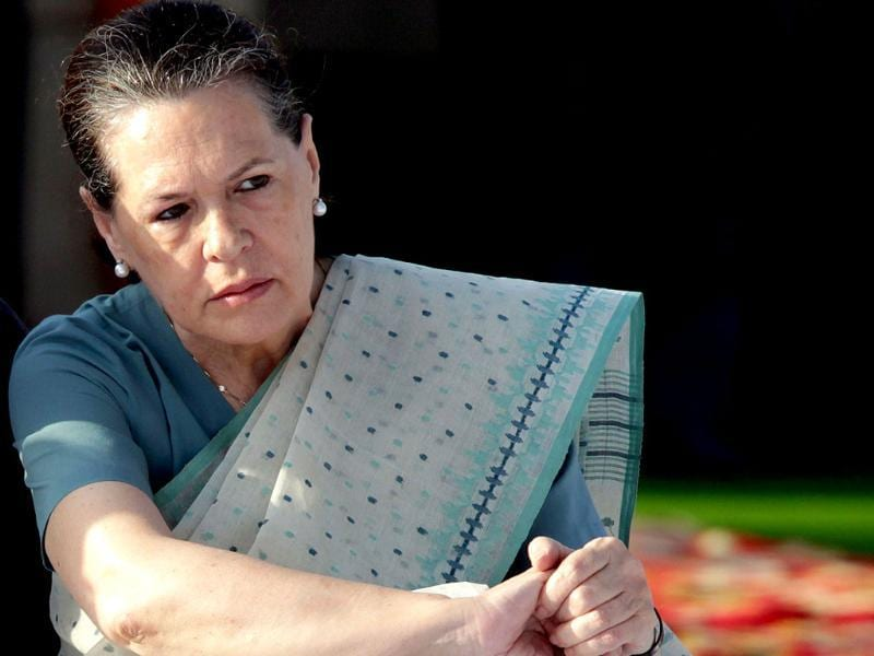 Chairperson of Congress-led UPA government Sonia Gandhi looks on after paying her respects at the memorial to the father of the nation Mahatma Gandhi at Rajghat in New Delhi.