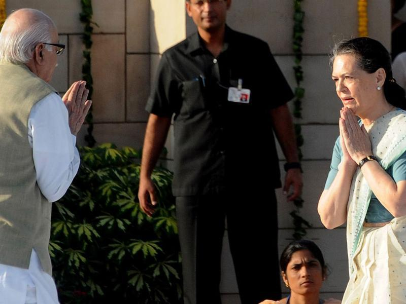 Chairperson of Congress-led UPA government Sonia Gandhi (R) is greeted by senior leader of Bharatiya Janata Party (BJP) Lal Krishna Advani (L) after paying their respects at Rajghat in New Delhi.