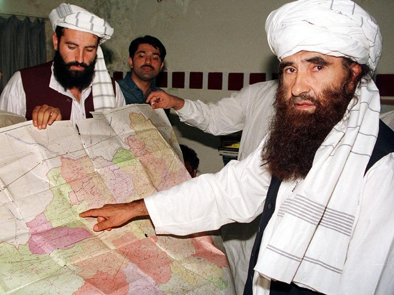 File Photo: Jalaluddin Haqqani (R), the Taliban's minister for tribal affairs, points to a map of Afghanistan during a visit to Pakistan while his son Naziruddin looks on.